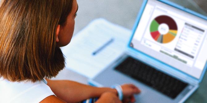 Woman using a laptop to make money plans