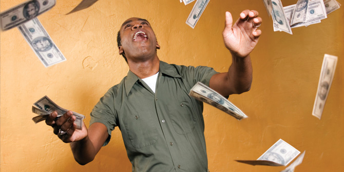 Man throwing bills in the air