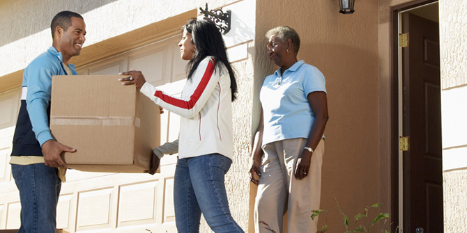 adult children moving their mother's boxes into their home