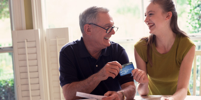man and teen with a credit card