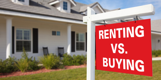 renting vs. buying yard sign in front of a house