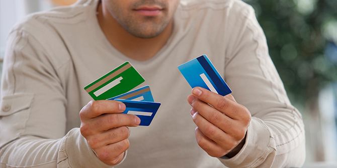 Man with credit cards in each hand