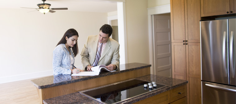 Woman signing loan papers