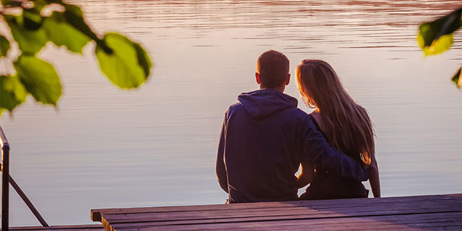 Young couple looking over a lake