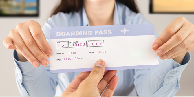 Person receiving boarding pass