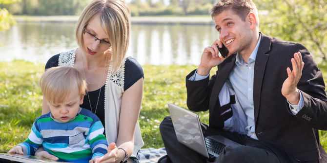 Couple working at park with kid