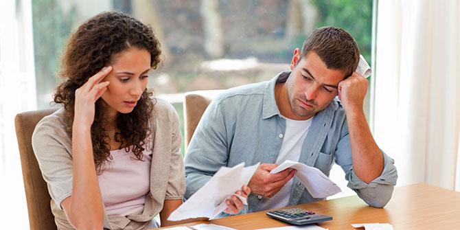 Couple examines bills