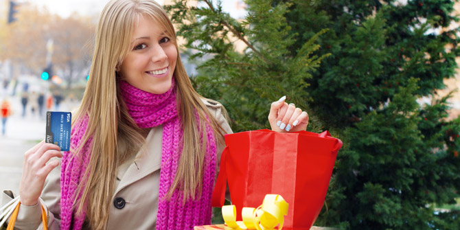 woman with credit card and shopping bag
