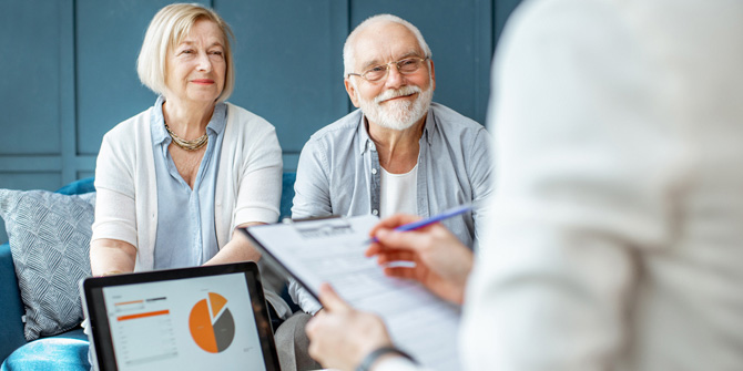 man and woman talking to a financial professional