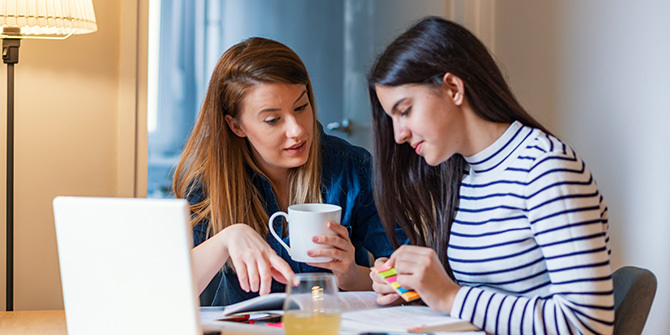 Woman talking to her teen daughter about finances