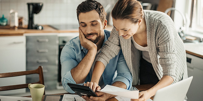 Young couple calculating home finances