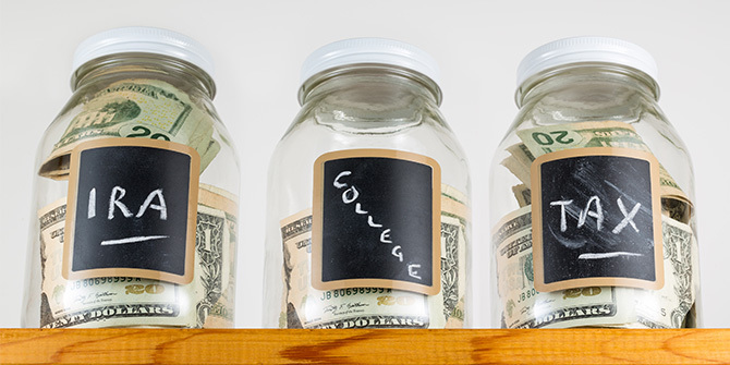 "Three jars labeled ""IRA,"" ""College,"" and ""Tax"""