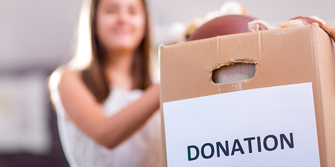 Woman filling up donation box