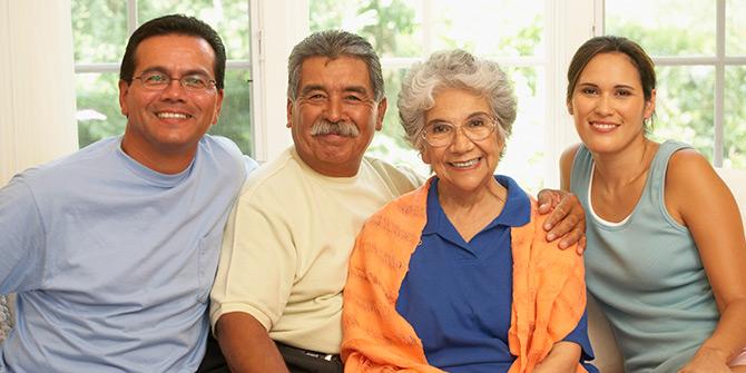 Elderly couple posing with their grown children