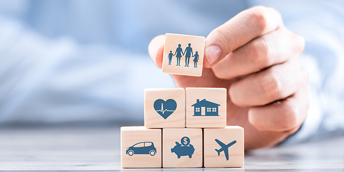 Wooden blocks with icons representing insurance types