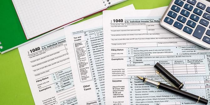 Tax forms, calculator, pen