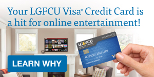 LGFCU Visa® Credit Card held in front of a television screen.