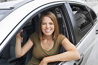 Woman in car holding keys