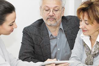 Woman reviewing documents with elderly couple