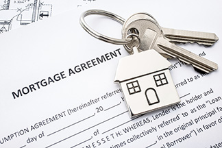 Mortgage loan papers and keys.