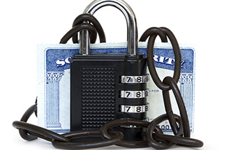 Lock and chain around a Social Security card