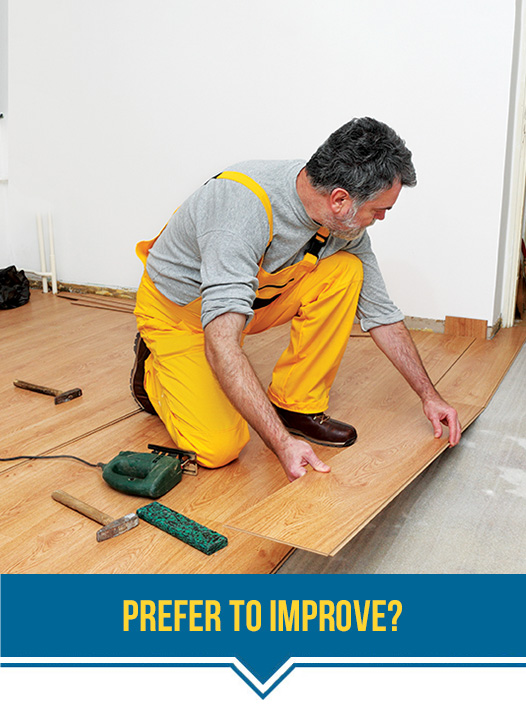Man working on flooring