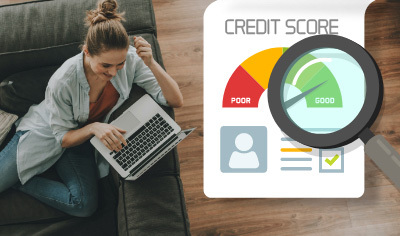 Woman checking credit score on laptop.