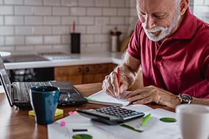 Senior man reviewing retirement distributions
