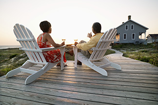 Two people sitting in deck chairs