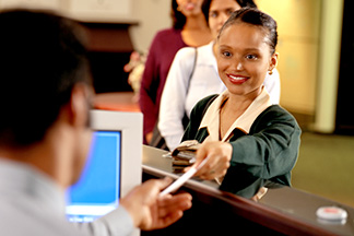 Woman handing ID to bank teller