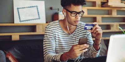 Young man shopping online with a credit card