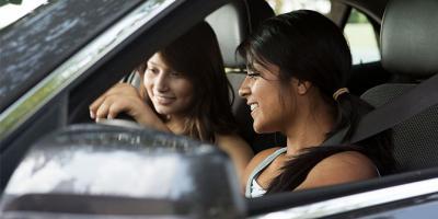 Teenage girls driving