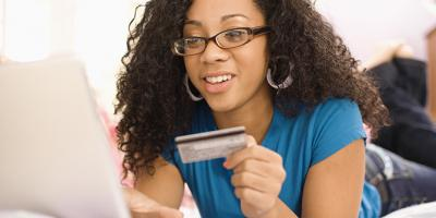 Girl on her laptop with a credit card