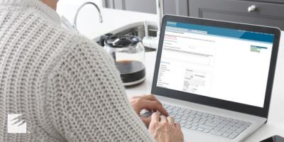 Woman submitting a loan application online.