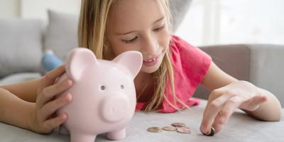 Girl with piggy bank and change