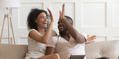 Excited couple give high five celebrating success