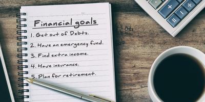 Financial goals written on note pad