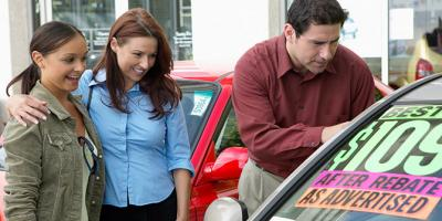 Family looking at used car for sale