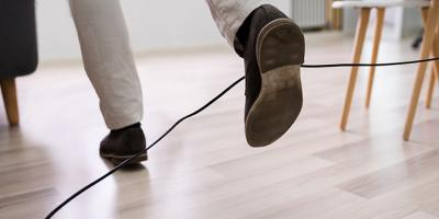 Male legs tripping over an electrical cord